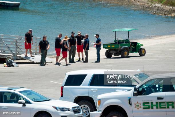 Divers and members of law enforcement gather during the search for actress Naya Rivera on July 10, 2020 in Lake Piru in Piru near Fillmore,...