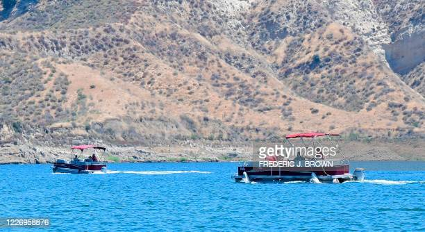 Divers and Ventura County Sheriffs are seen on boats on Lake Piru north of Los Angeles California on July 13 where a body presumed to be missing Glee...