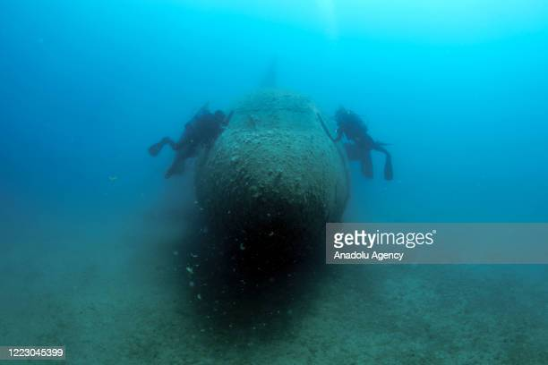 Divers at Airbus A300 airplane wreck which was put to the bottom of the sea off the resort of Kusadasi and became an artificial reef in Aydin, Turkey...