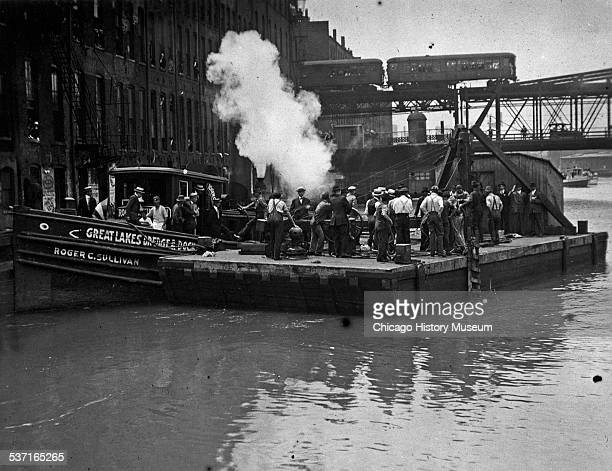 Divers at work on a barge after the Eastland Disaster, Chicago, Illinois, 1915.
