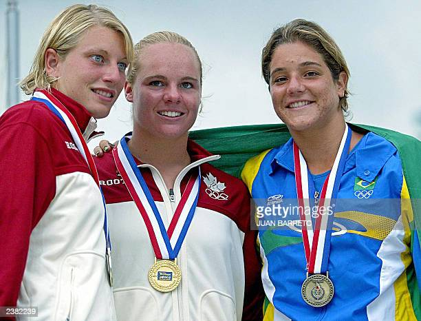 Divers Blythe Hartley and Emilie Heymans from Canada and Juliana Veloso from Brazil pose after receiving their medals at the XIV Pan American Games...