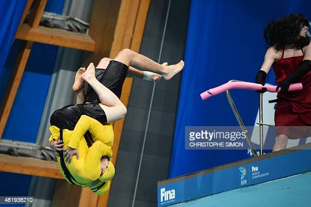 Divers dressed as 'The Minions' perform a show before the podium ceremony of the women's 3m Springboard Synchronised final diving event at the 2015...