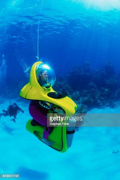 divers driving submersibles - submarine stock pictures, royalty-free photos & images