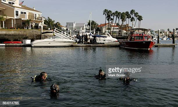 –Divers from several different law enforcement agencies search in Huntington Harbor for blasting caps that had been initially spotted by other divers...