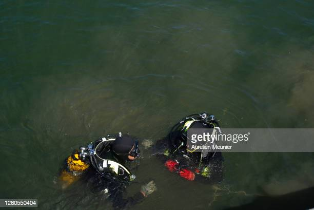 Divers from the Paris police are looking for bicycles in the Seine during a training exercise on July 27, 2020 in Paris, France. This unit of the...