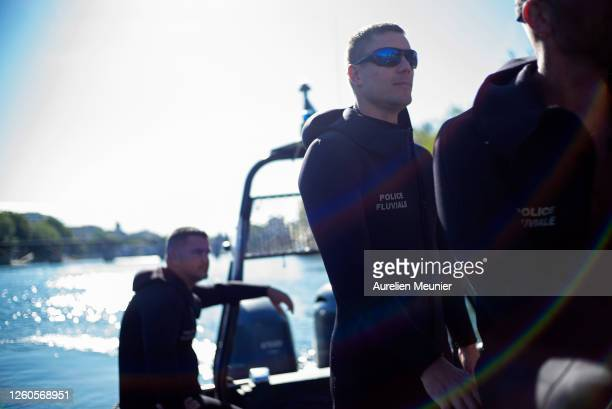 Divers from the Paris police in the zodiac as they patrol along the river Seine during a training exercise on July 27, 2020 in Paris, France. This...