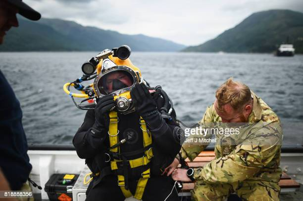 Divers from the Royal Navy and the British Sub-Aqua Club are recovering two Highball bouncing bombs from Loch Striven on July 19, 2017 in Loch...