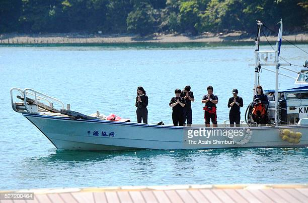 Divers observe a minute of silence for the Minamata Disease victims at Eco Park Minamata on May 1 2016 in Minamata Kumamoto Japan On May 1 the head...
