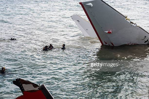 Divers of Indonesian Search and Rescue Agency try to search CVR inside the Lion Air plane wreckage on April 15 2013 in Badung Bali Indonesia The Lion...