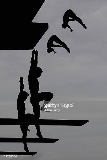 Divers practice ahead of the Men's 10m Platform Synchro preliminary round during Day Two of the 14th FINA World Championships at the Oriental Sports...
