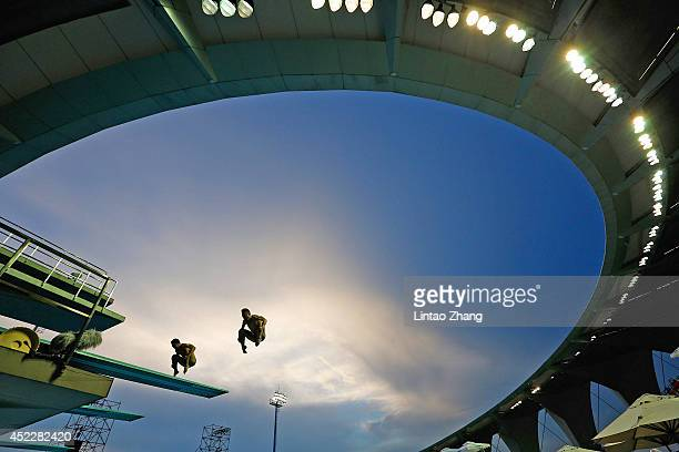 Divers practice during day three of the 19th FINA Diving World Cup at the Oriental Sports Center on July 17 2014 in Shanghai China