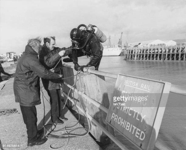 Divers search Newhaven Harbour for signs of the missing Lord Lucan after a car he borrowed from a friend was found abandoned nearby 25th November 1974