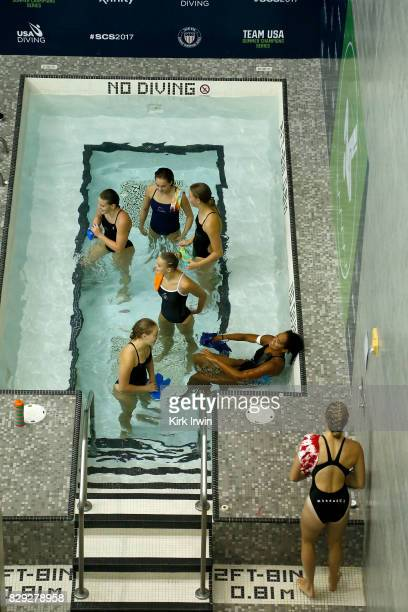 Divers sit in the hot tube while waiting to take their next dives during the Senior Women's 3m Springboard Preliminary during the 2017 USA Diving...