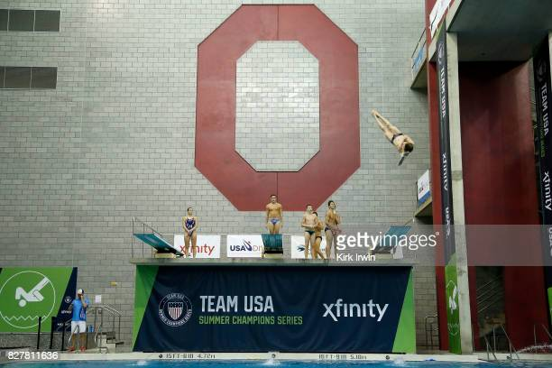 Divers take advantage of some training time to get in some practice prior to the start of the Senior Women's 1m Springboard Final during the 2017 USA...