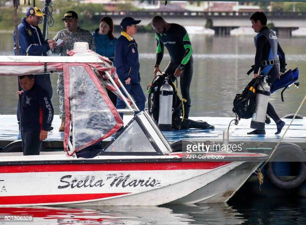 Divers take part in the search for survivors after the tourist boat Almirante sank in the Reservoir of Penol in Guatape municipality in Antioquia...