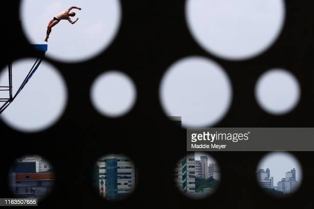 Divers warm up before the Men's High Dive during the Gwangju 2019 FINA World Championships at Chosun University on July 22 2019 in Gwangju South Korea