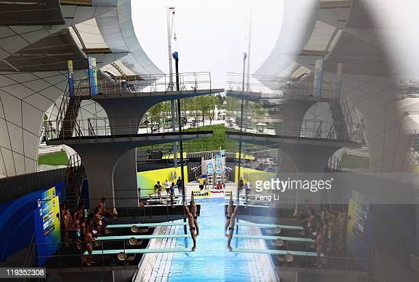 Divers warm up during a training session prior to the Men's 3m Springboard Synchro Final during Day Four of the 14th FINA World Championships at the...