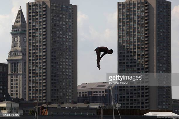 Divers who will compete in Saturday's Red Bull Cliff Diving World Series practice jumping from the platform built onto Boston's Institute of...