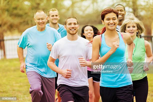 Diverse adults exercising with running club group