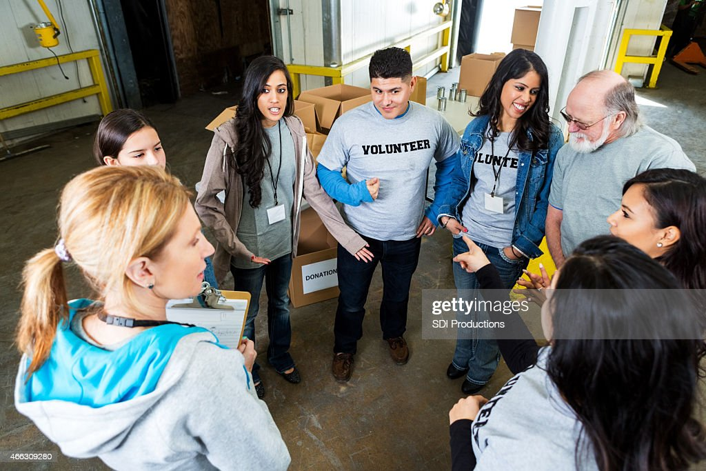 Diverse Adults Volunteering In Food Bank Together Stock Photo ...