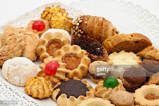 Diverse assortment of Italian cookies on white plate