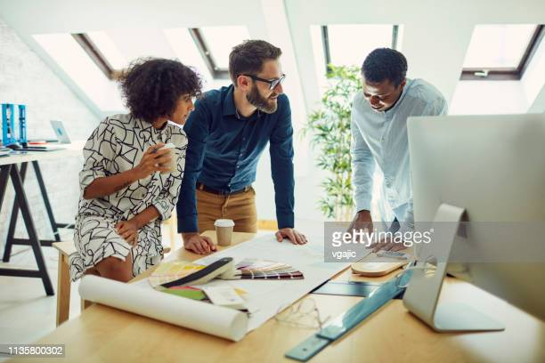diverse business team - interior designer stock pictures, royalty-free photos & images