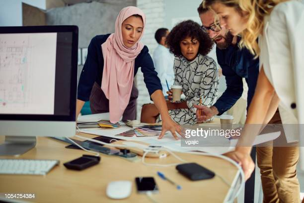 diverse business team working in the office - hijab stock pictures, royalty-free photos & images