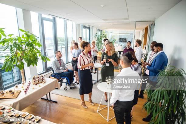 diverse businesspeople at new business launch party - launch event imagens e fotografias de stock