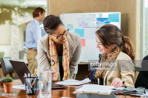 diverse businesswomen work together on project - administrator stock pictures, royalty-free photos & images