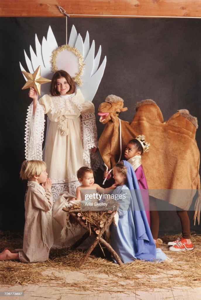Diverse children acting in nativity scene : Stock Photo