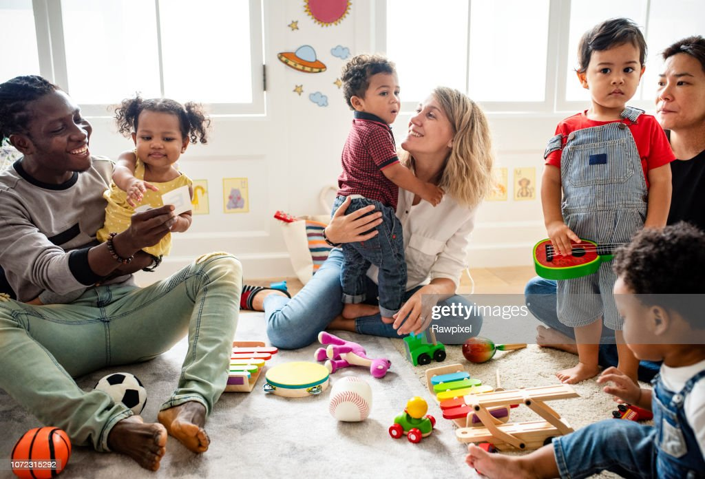 Diverse children enjoying playing with toys : Stock Photo