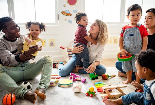 Diverse children enjoying playing with toys 1072315292