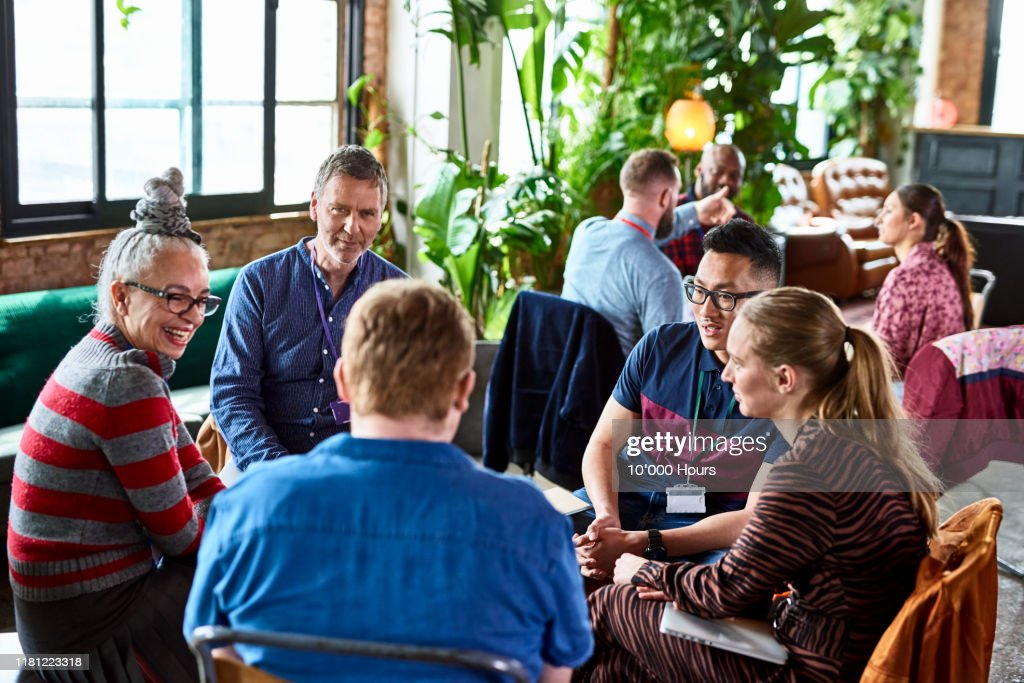 Diverse colleagues meeting in open office space : Stock Photo