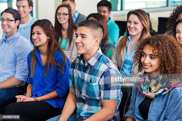 Diverse college students attending assembly or orientation meeting