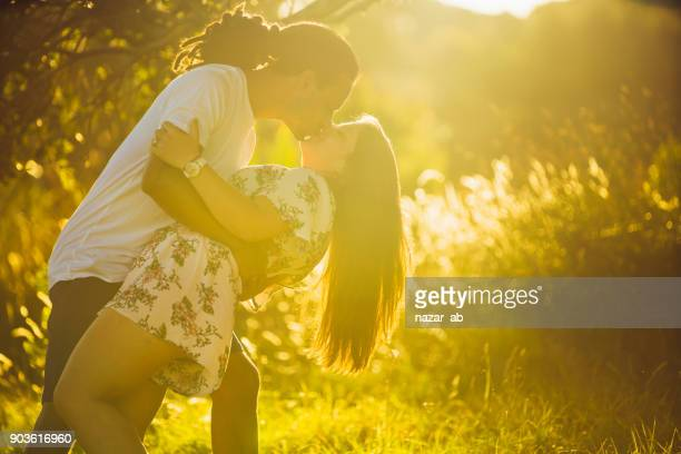 Diverse couple enjoying outdoors.