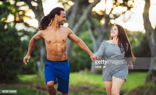 Diverse couple running.