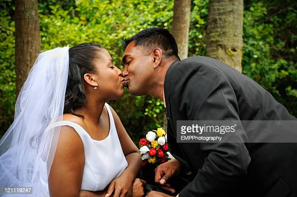 Diverse Couple Sharing a Wedding Kiss
