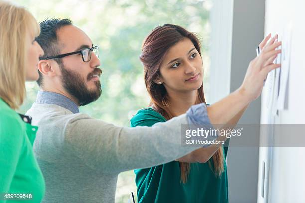 Diverse creative team in modern office working on project together
