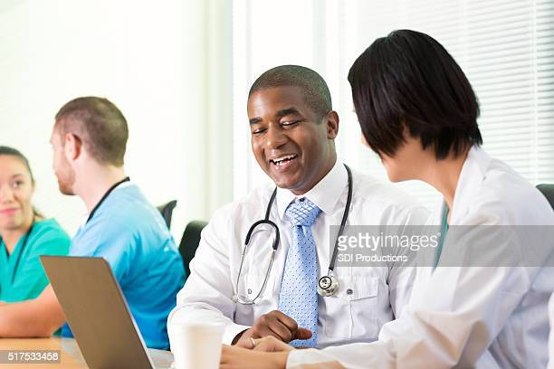 Diverse doctors in medical staff meeting