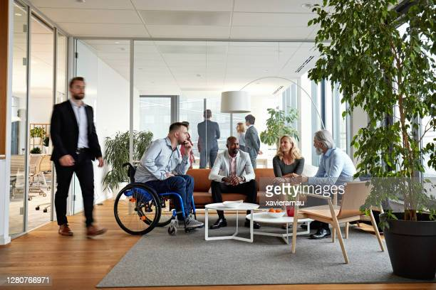 diverse executive team meeting in office reception room - multi ethnic group stock pictures, royalty-free photos & images