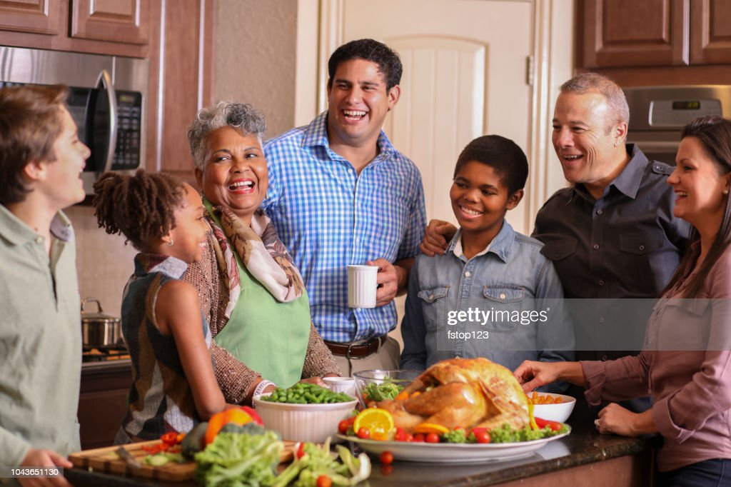Diverse family in home kitchen cooking Thanksgiving dinner. : Stock Photo