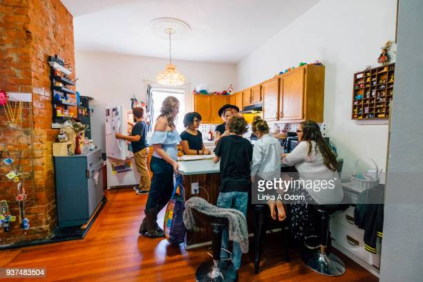 Diverse Family Playing Game in Kitchen