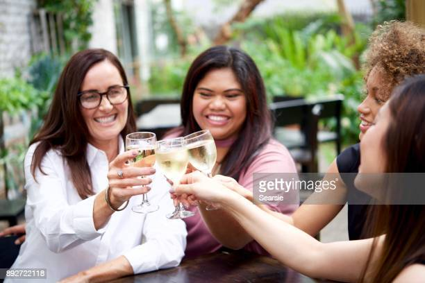 SYD112017 Diverse females drinking wine in summer