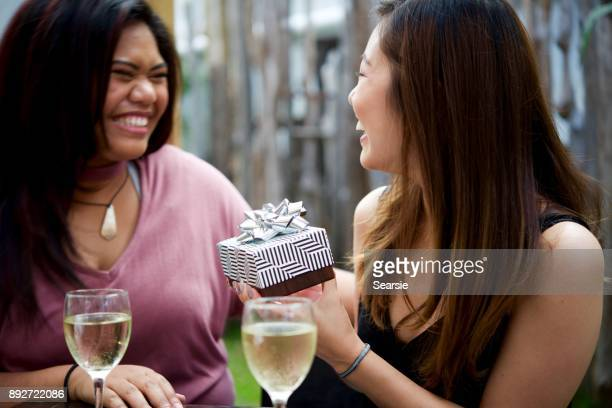 SYD112017 Diverse females exchanging gifts