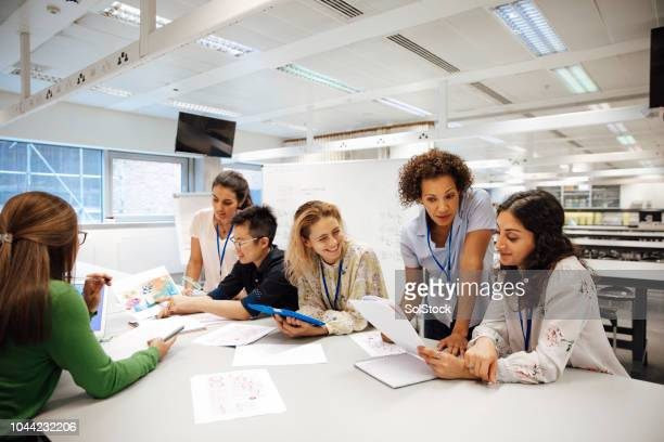 diverse females involved in stem - organized group stock pictures, royalty-free photos & images
