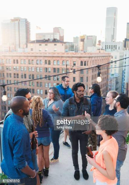 Diverse friend group having roof party