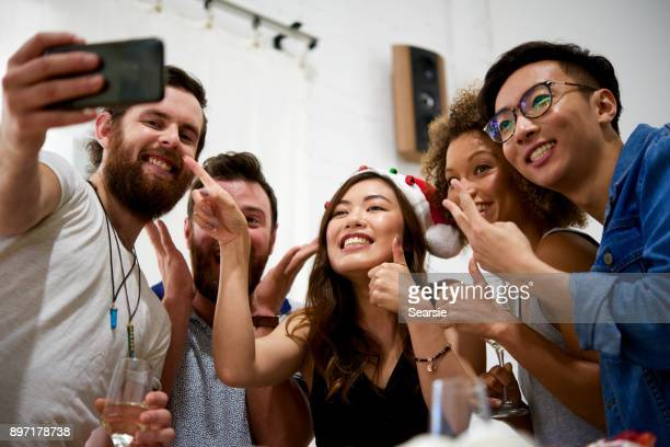 SYD112017 Diverse friends at a party taking a selfie