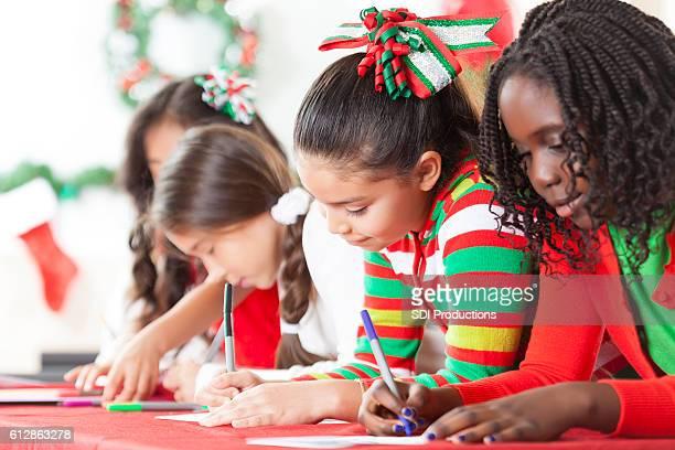 Diverse friends creat Christmas cards