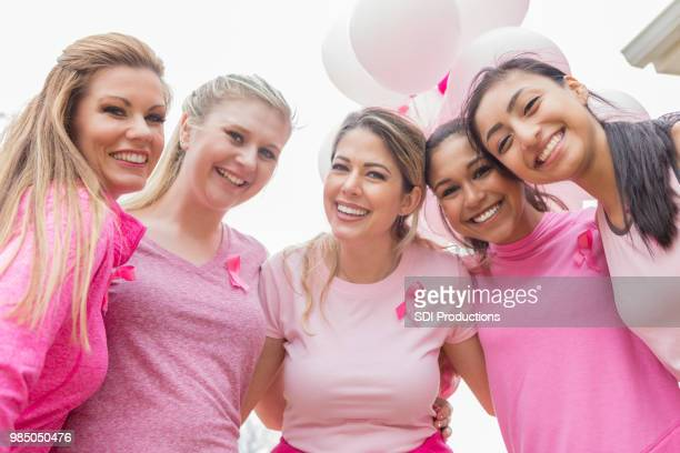 diverse friends during charity fundraiser - survival stock pictures, royalty-free photos & images