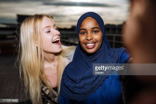 diverse friends taking selfie and smiling - 18 19 years stock pictures, royalty-free photos & images